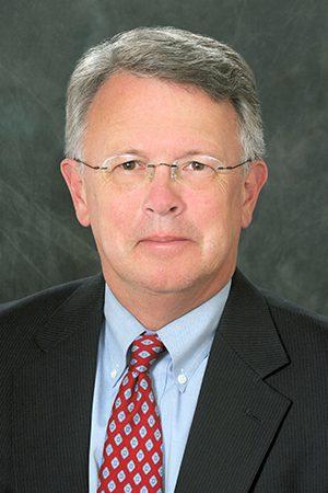 MALCOLM L. COLLINS