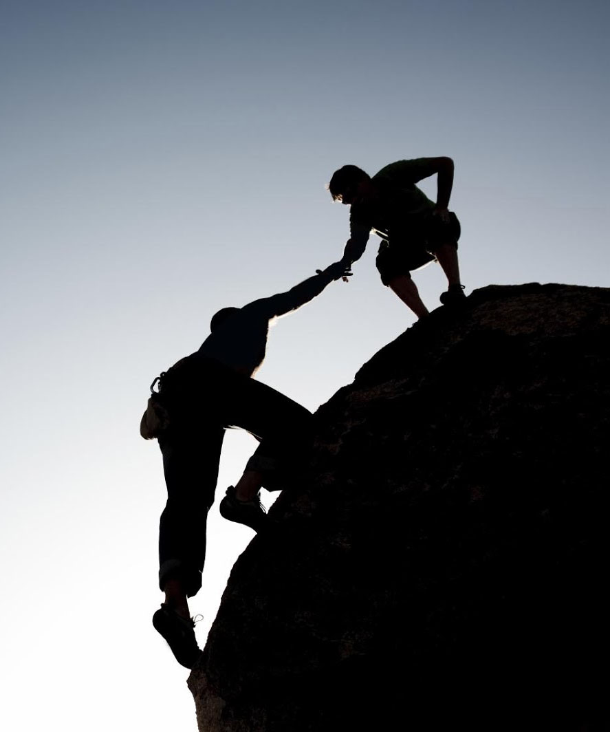 climber lifting - we lift ourselves by lifting others