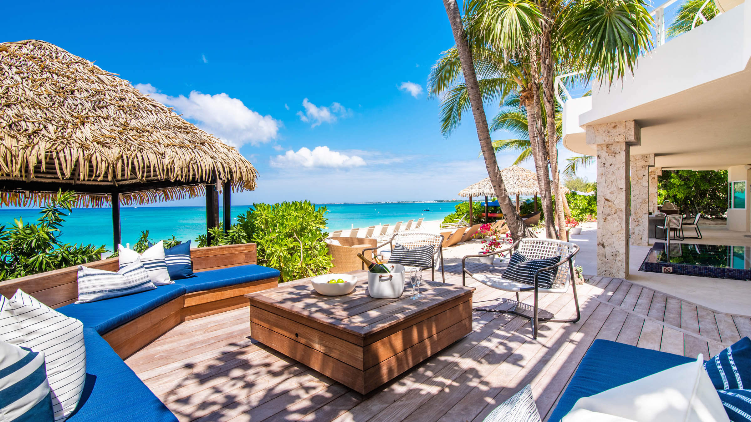 Seascape-Villa-Beach-Villa-Cayman-Islands-Grand-Cayman-Paradise-Beachfront-Deck-Outdoor-Lounge-Chairs-and-Seating-Area-Ocean-View.jpg