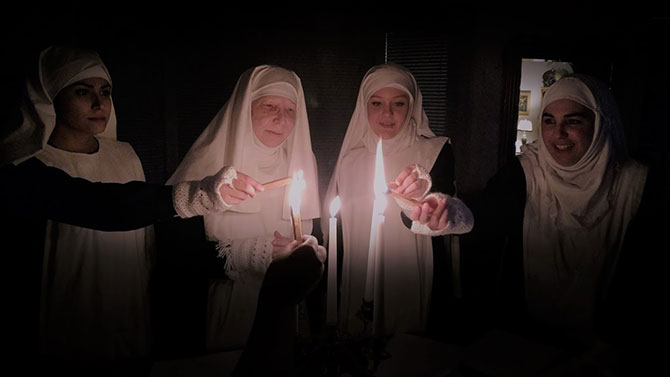 Sisters Lit Candles