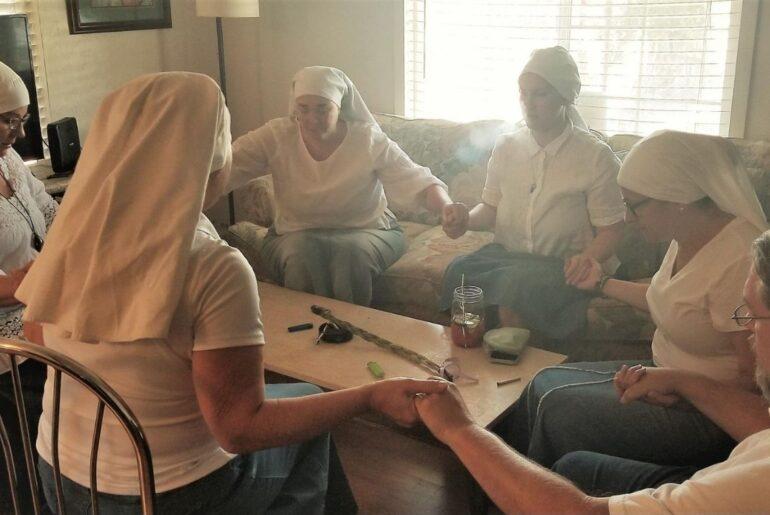 sisters praying