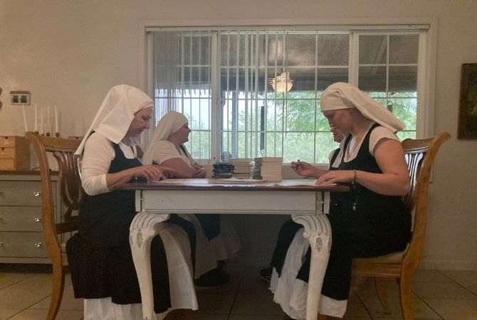 sisters reading at the table