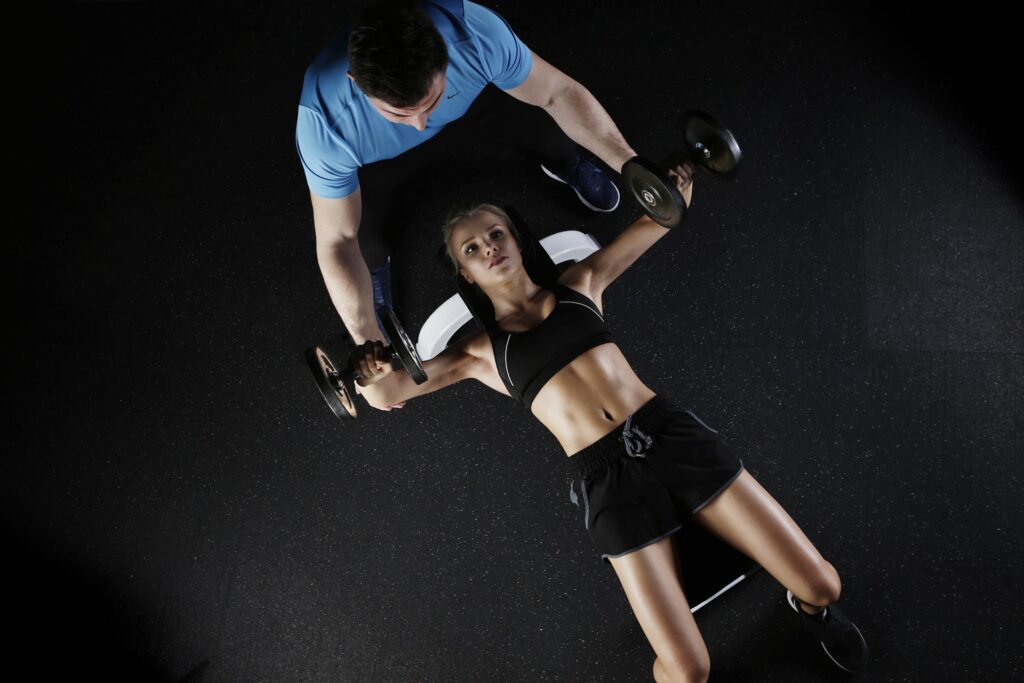 How does training improve performance in sports