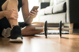 man using phone for workouts
