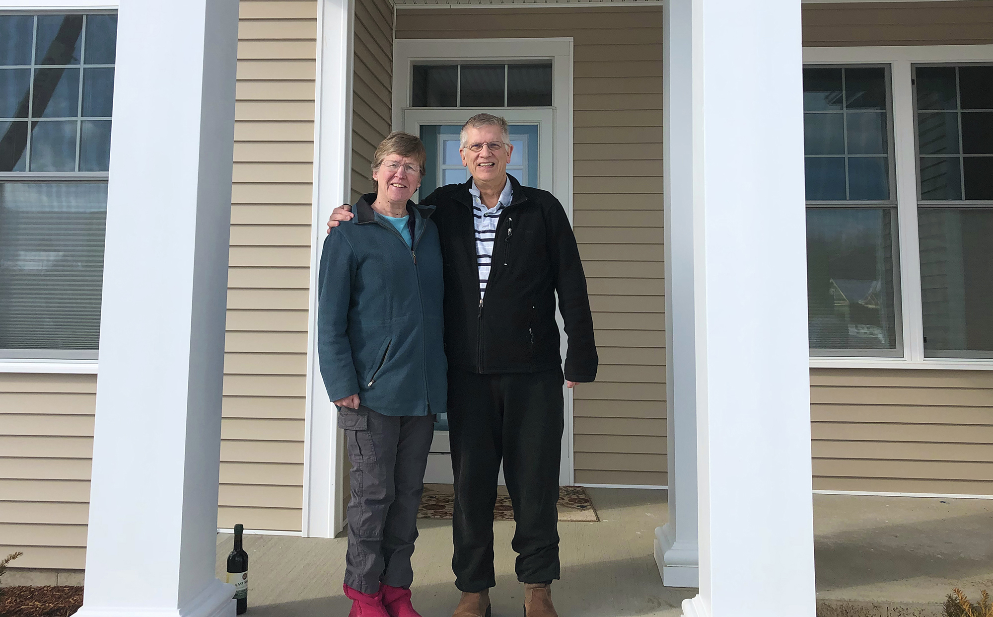 man and woman standing in front of a home that was sold by ben durant