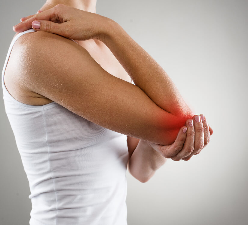woman holding her elbow in pain