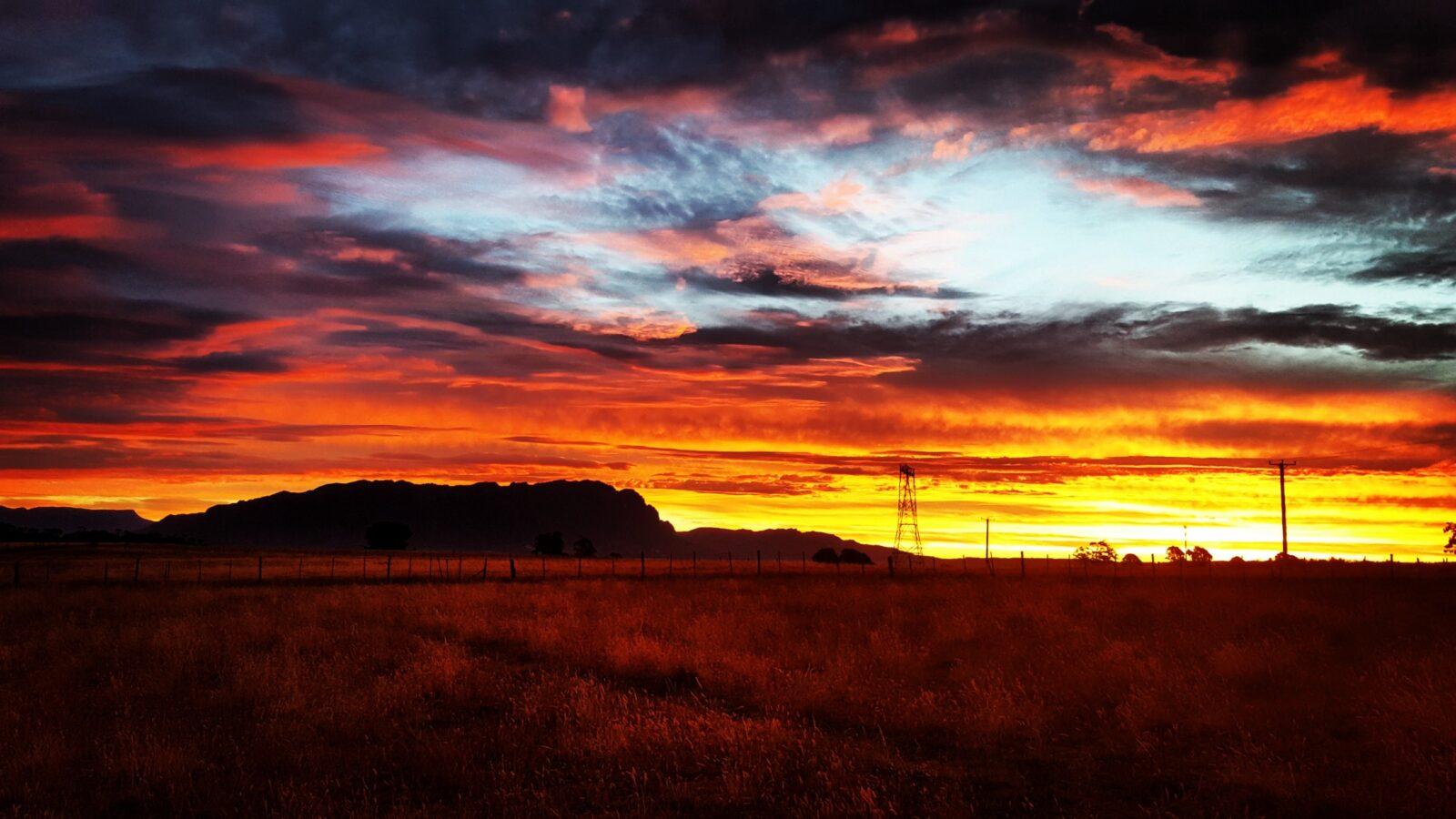Stunning sunset photo across Mount Roland in Tasmania
