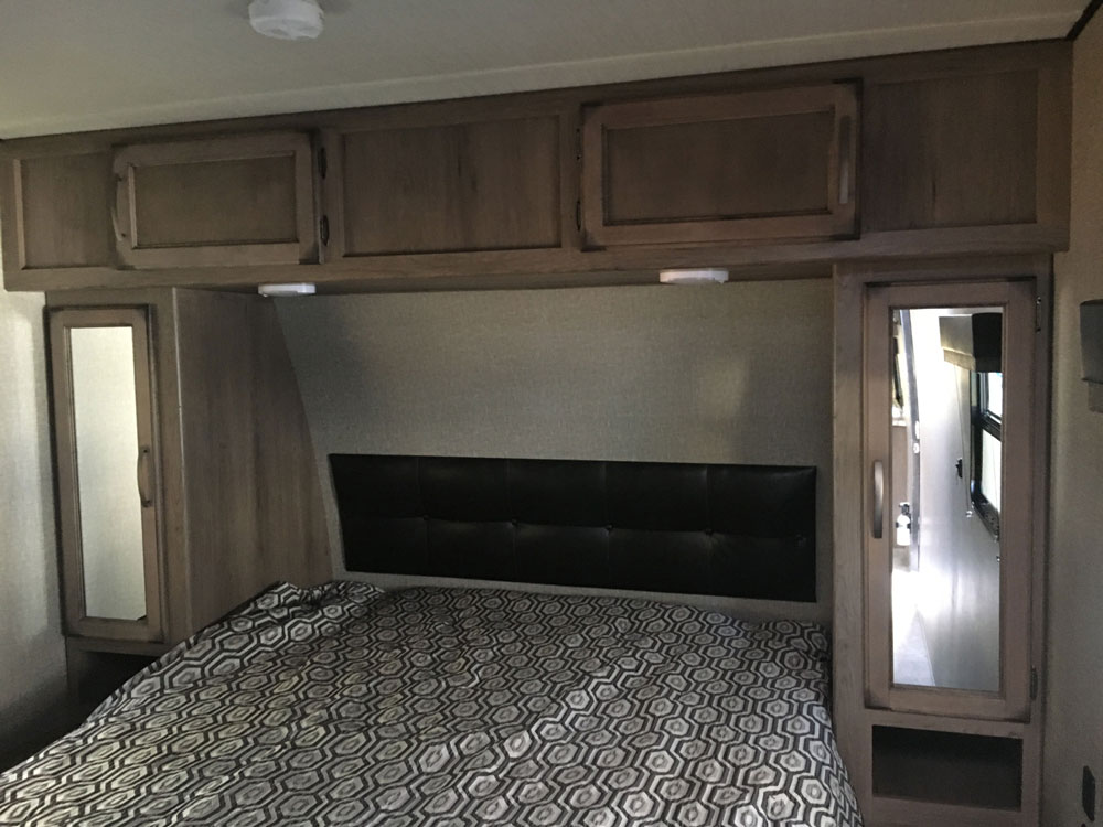 Full Size Queen Bed and Storage Cabinets in Grand Design Transcend 28MKS