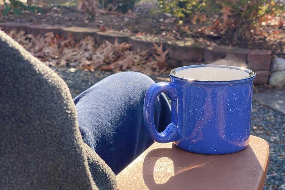 Enjoying a Mug of  Camping Coffee on a Cool Day
