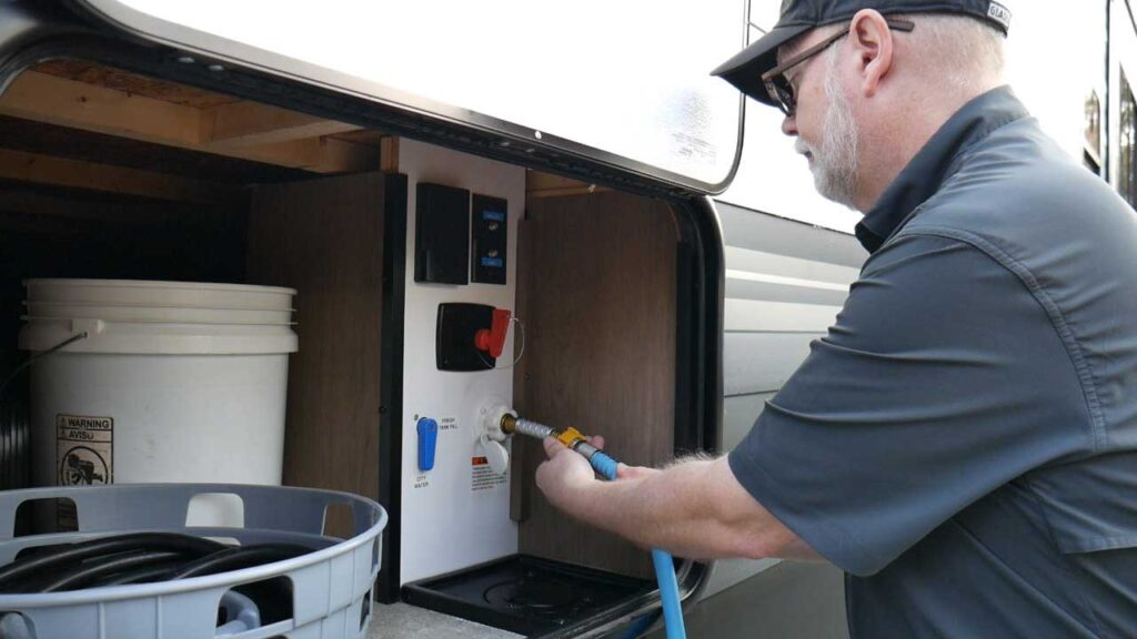 Connect a Freshwater Hose to Help With Dewinterizing a Travel Trailer