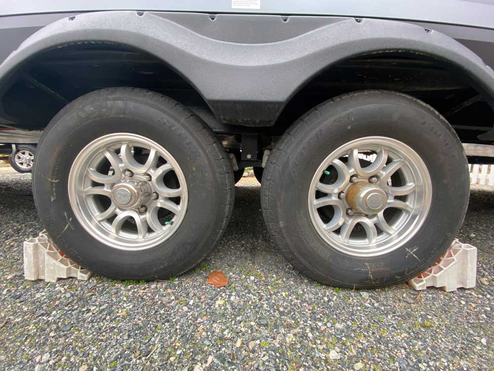 Old faded chocks shown with travel trailer tires