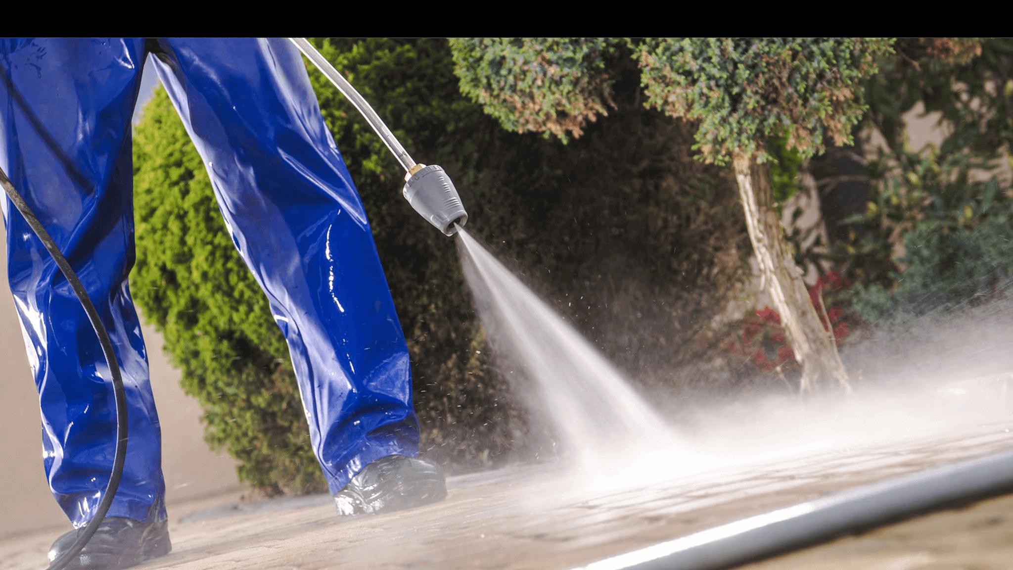 man-about-to-finish-power-washing-driveway