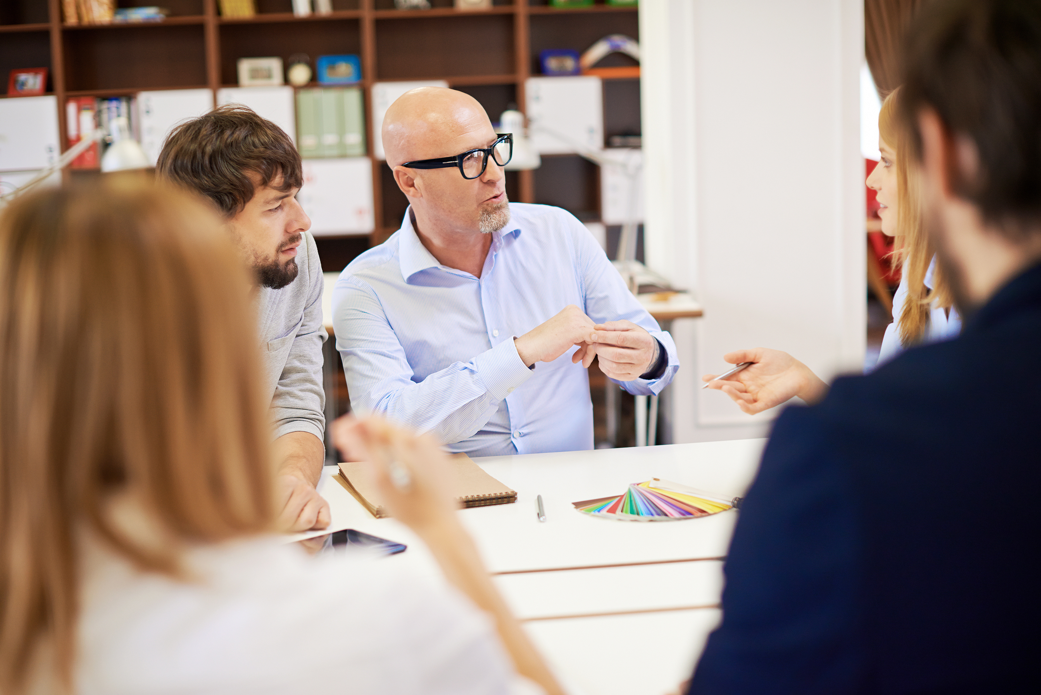 Team Of Designers Discussing During A Meeting