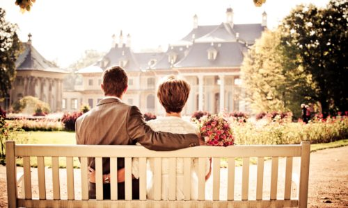Couple looking at their estate home