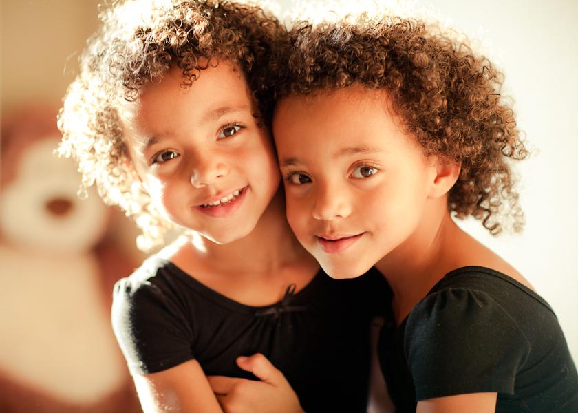 Two kids hugging