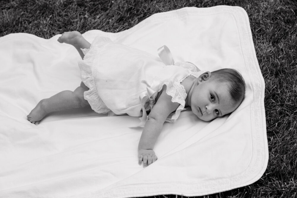 black and white photograph child on blanket
