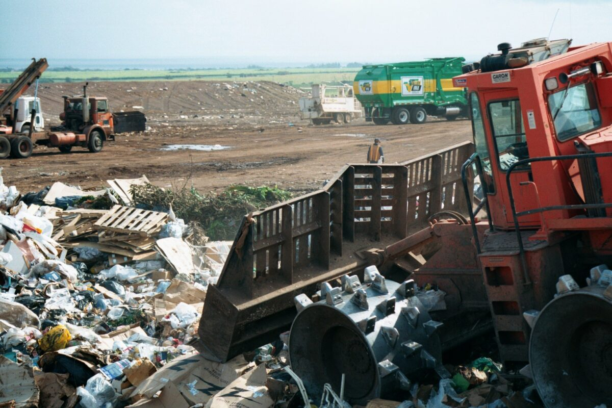 Compactor pushing trash at a landfill