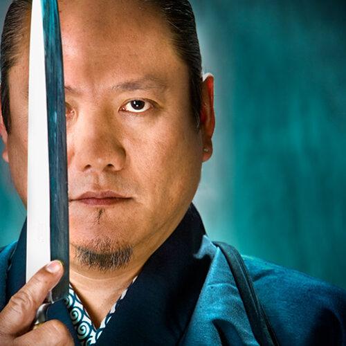 Iron Chef Morimoto holding knife