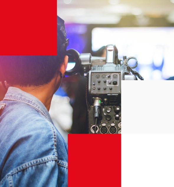 Video camera operator using camcorder