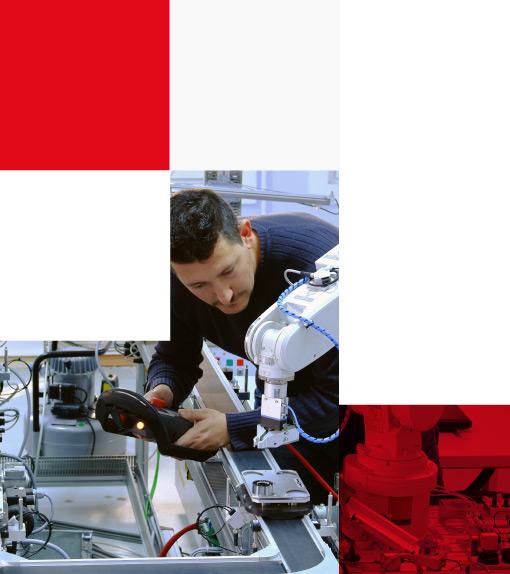 engineer programming robotic arm with control panel