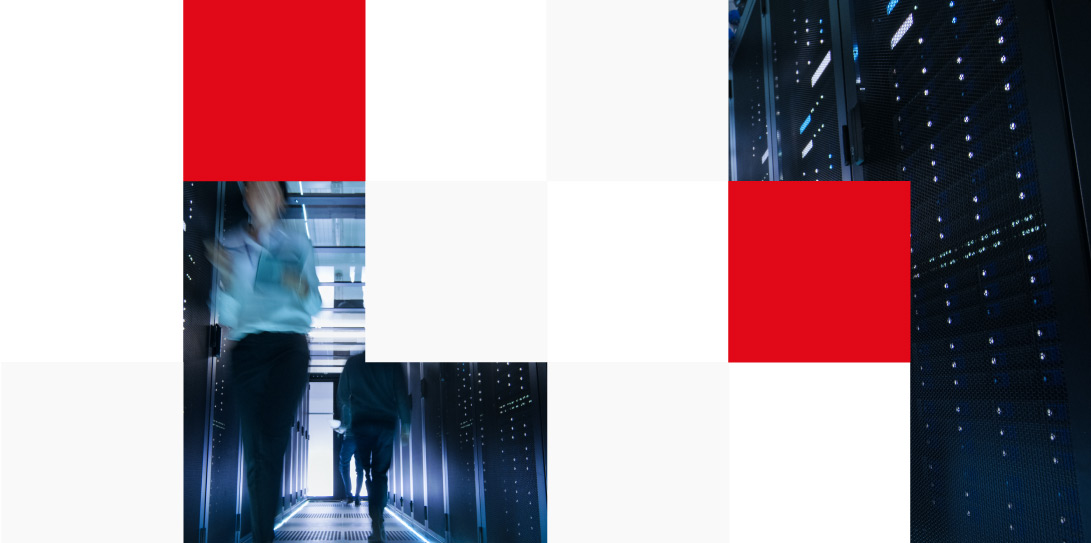 engineers walking on a large data centre corridor