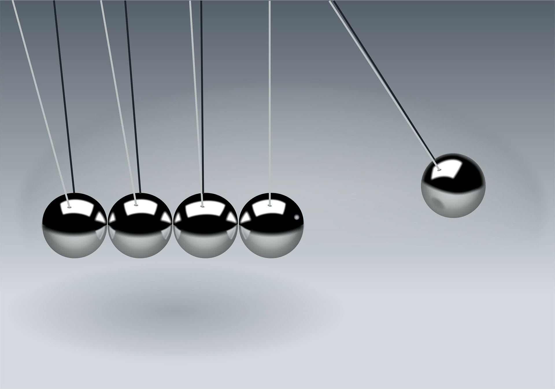 newtons cradle on grey background