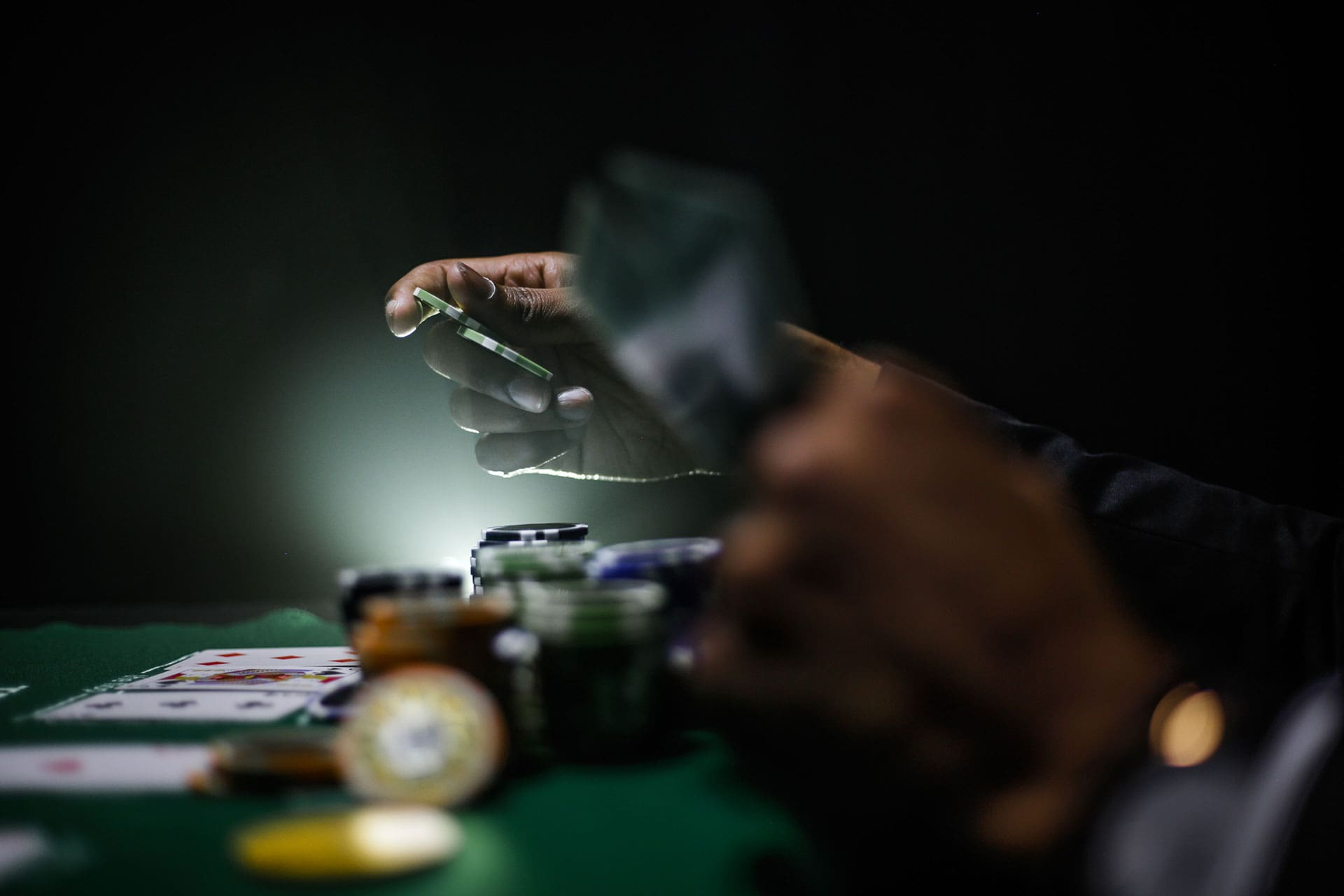 man playing poker holding chips