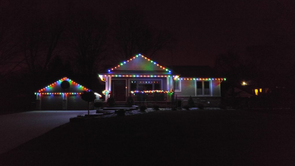 Bungalow with multi-colour roofline and railing garland