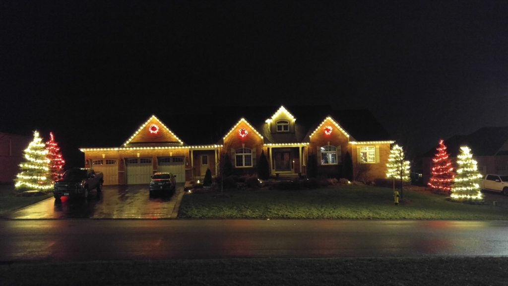 Red and White theme. White roofline, red wreaths, mixed trees