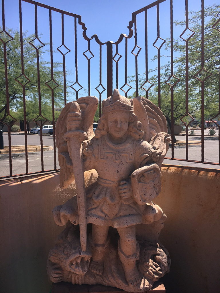 St. Michael the Archangel guards the memorial garden.