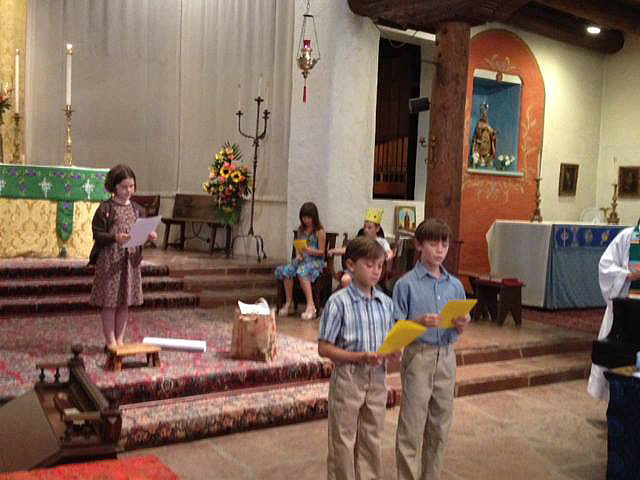 Young Family Mass participants reenact a scene from the Bible