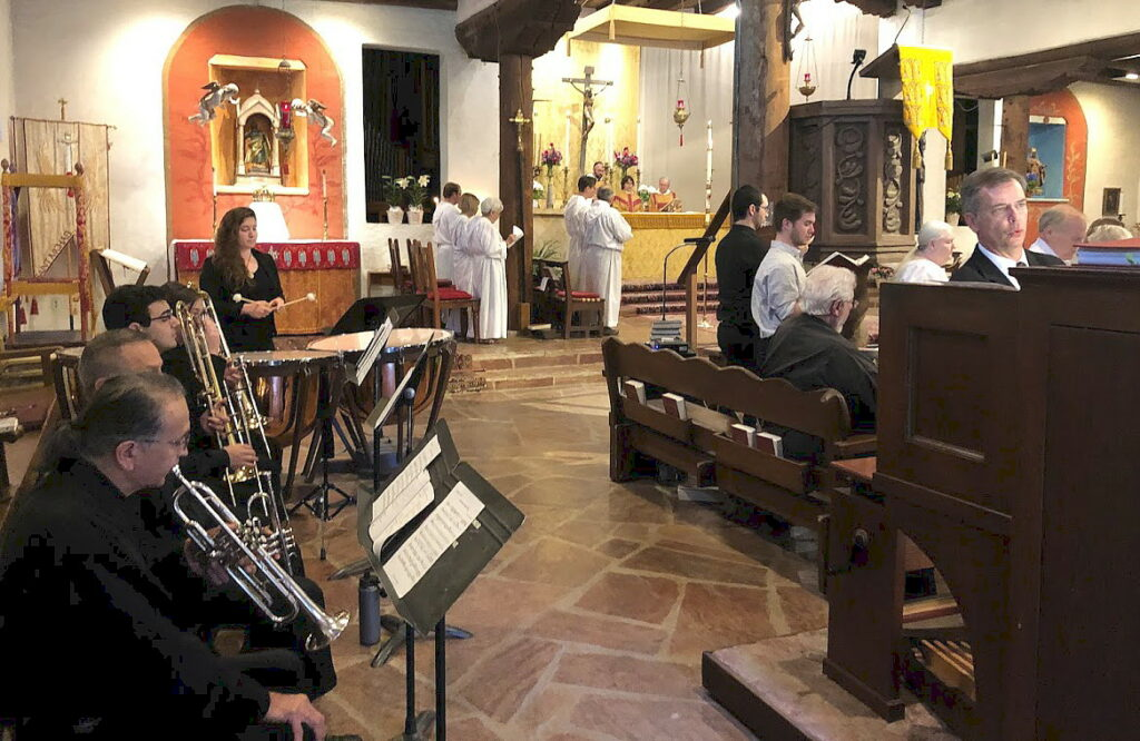 Choir, organist and guest musicians play together at the Easter morning solemn mass.
