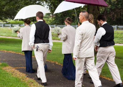 """3 white and 1 peachy-ivory 60"""" umbrellas (in case of rain for outdoor venues)"""