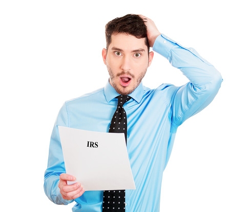 Closeup portrait, sad, shocked funny looking young man disgusted at his IRS statement, isolated white background. Negative human emotion facial expression feelings. Financial crisis, bad news