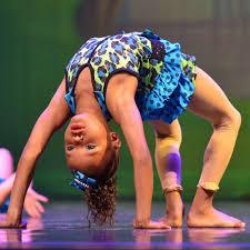 Young girl doing acrobats-