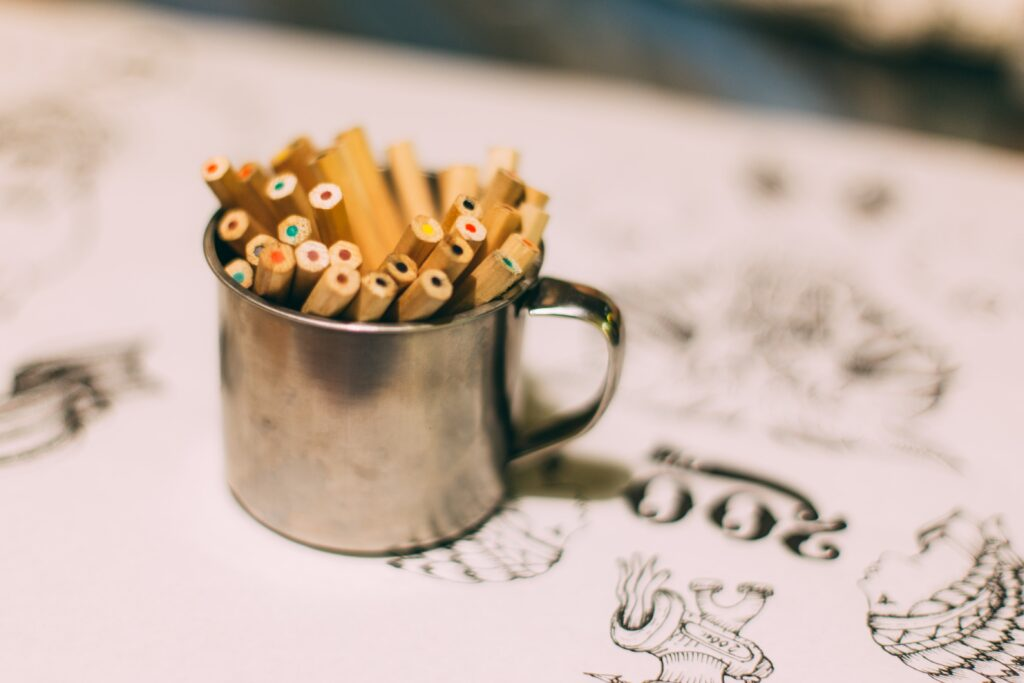 colored pencils in a silver cup