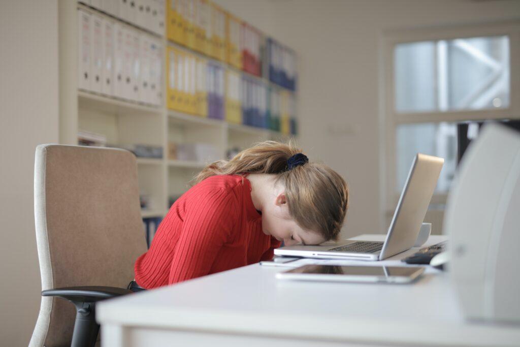 girl falling asleep on her computer