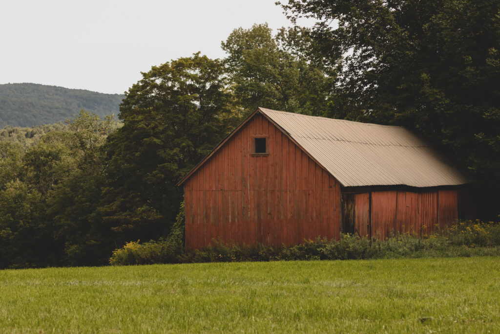 A red barn in hills of Woodstock Vermont.