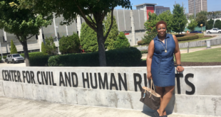 Mommy Talk Show Host Joyce Brewer is standing in front of the Center for Civil and Human Rights