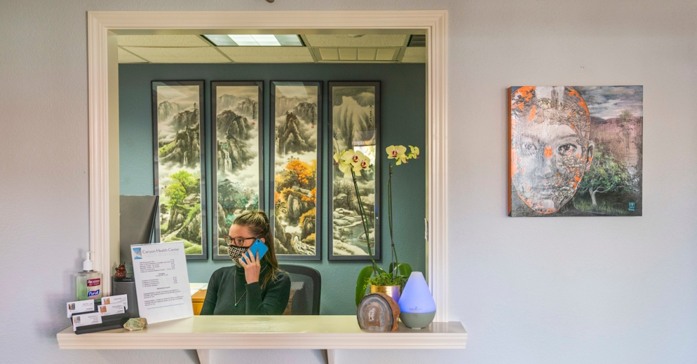 receptionist with a mask