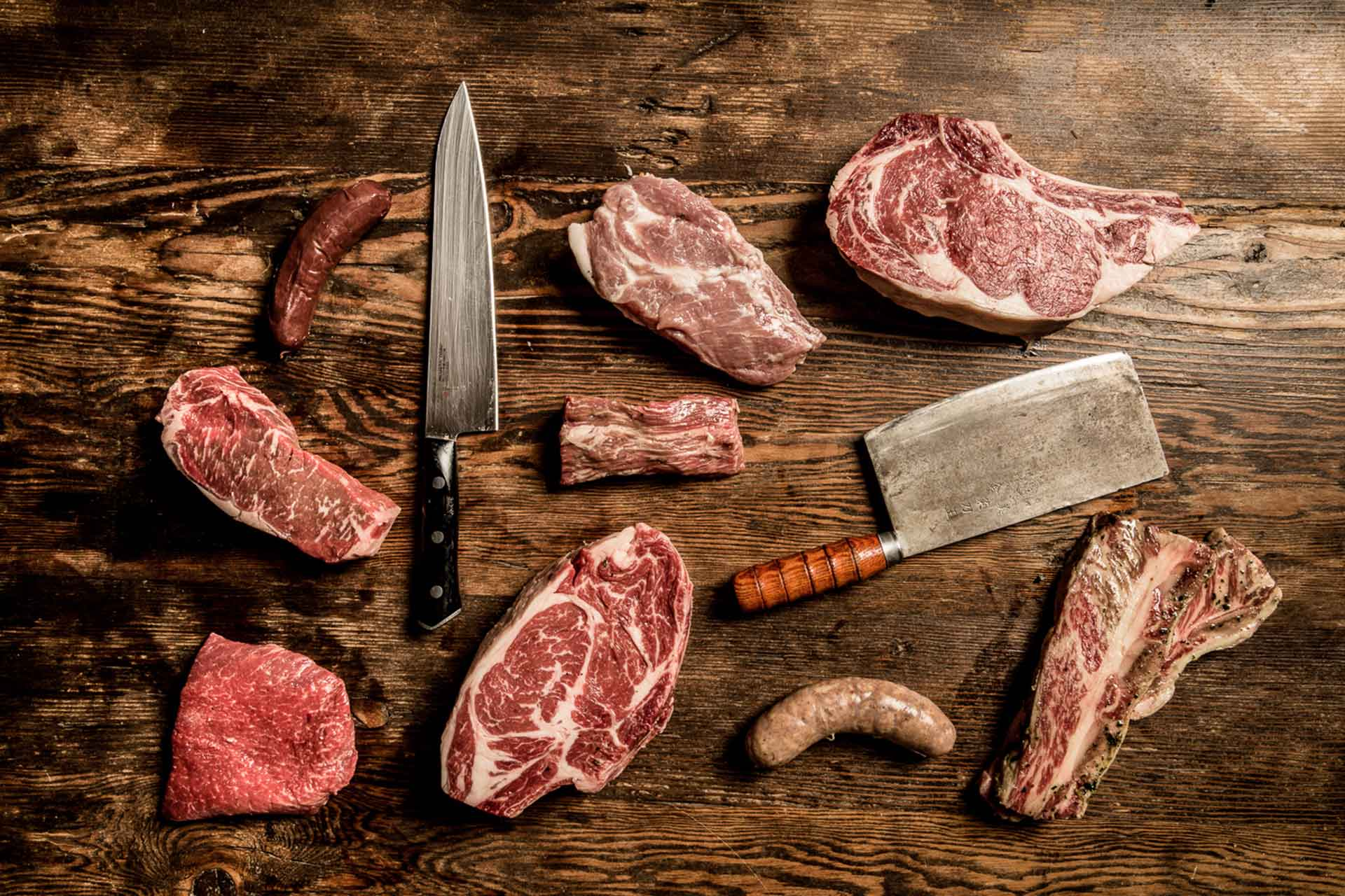 various steak cuts and cutlery