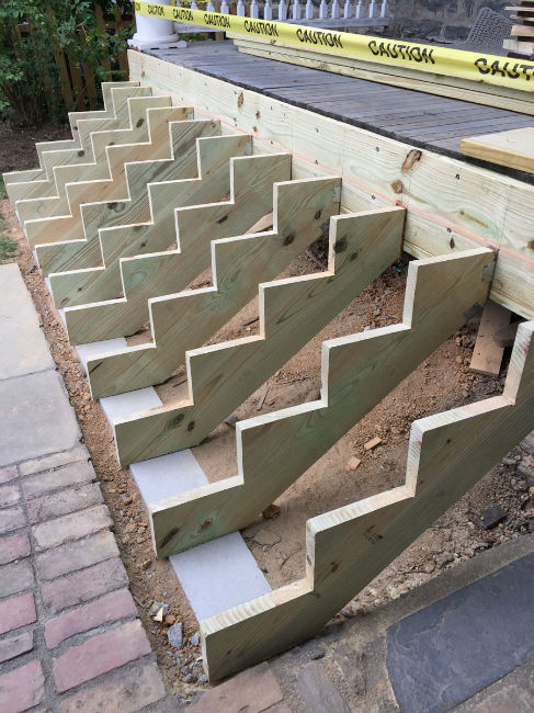 Installing New Stringers for Porch Stairs in Remodeling Job on the Pennsylvania Main Line