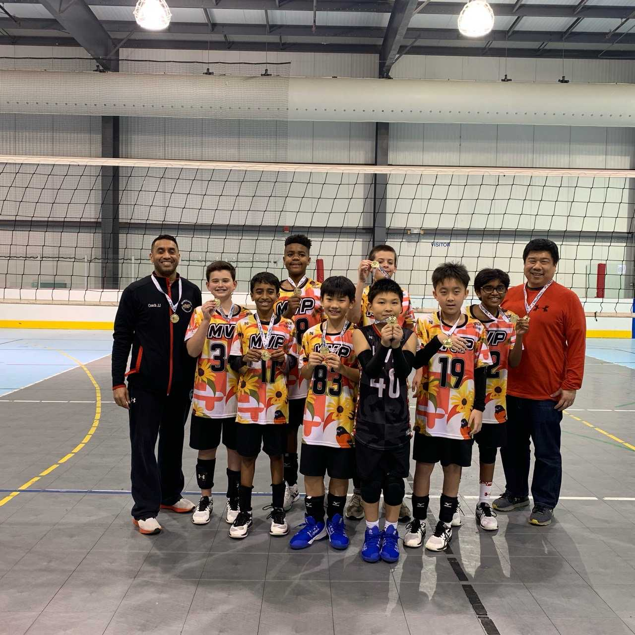 MVP 12s holding gold medals