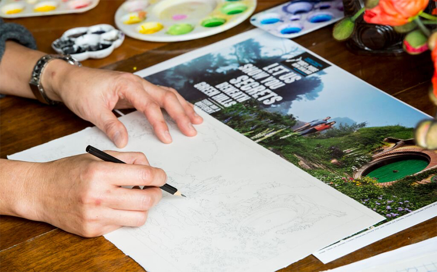 Artist Gabby Malpas creating the sketches. Photo: Tourism New Zealand