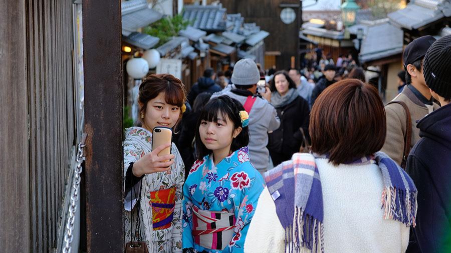 Visitors taking a selfie in Higashiyama, Kyoto
