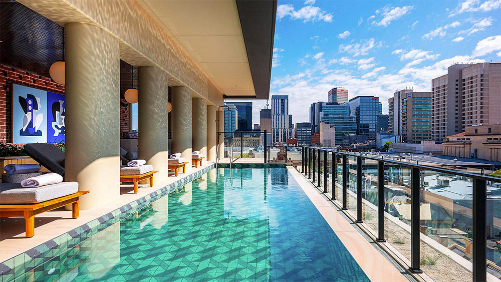 A pool with a view at Hotel Indigo Adelaide Markets