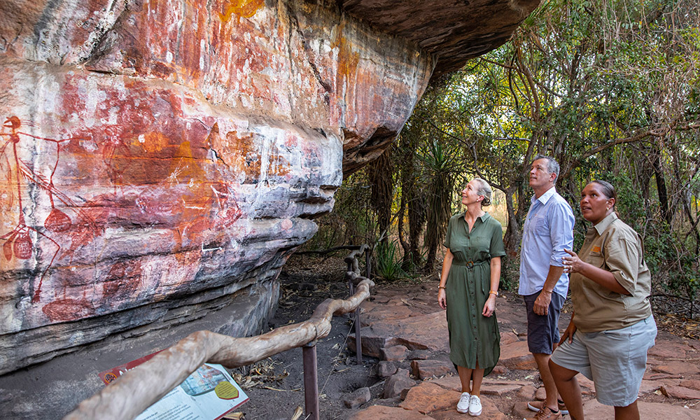 Viewing ancient rock art at Ubirr. Credit: Tourism Northern Territory