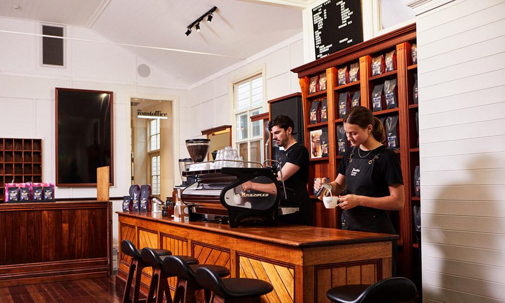 Bastion Lane's team and La Marzocco Strada espresso machine. Credit: Supplied.