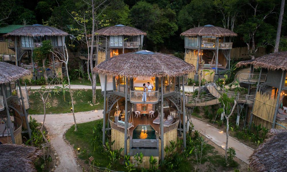 Multi-level treehouses accessed via rope bridges. Credit: TreeHouse Villas