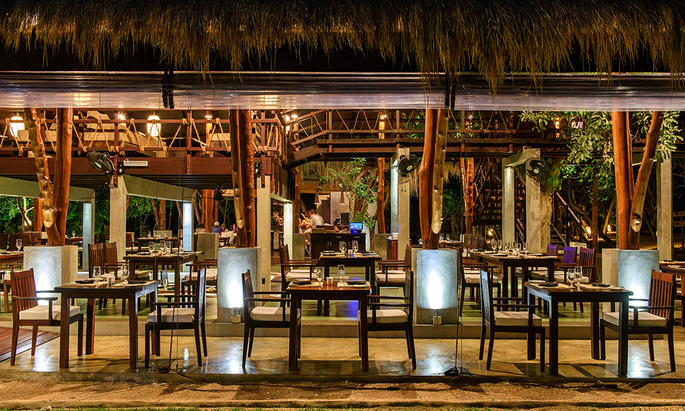 The open-air dining room at Jungle Beach. Credit: Uga Escapes
